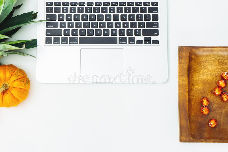 Top View of Silver Macbook Beside Pumpkin and Brown Wooden Tray stock photos