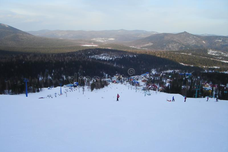 Top view of a ski resort and long downhill route stock photo