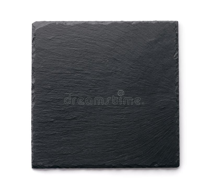 Top view of slate black stone plate. Isolated on white stock photos