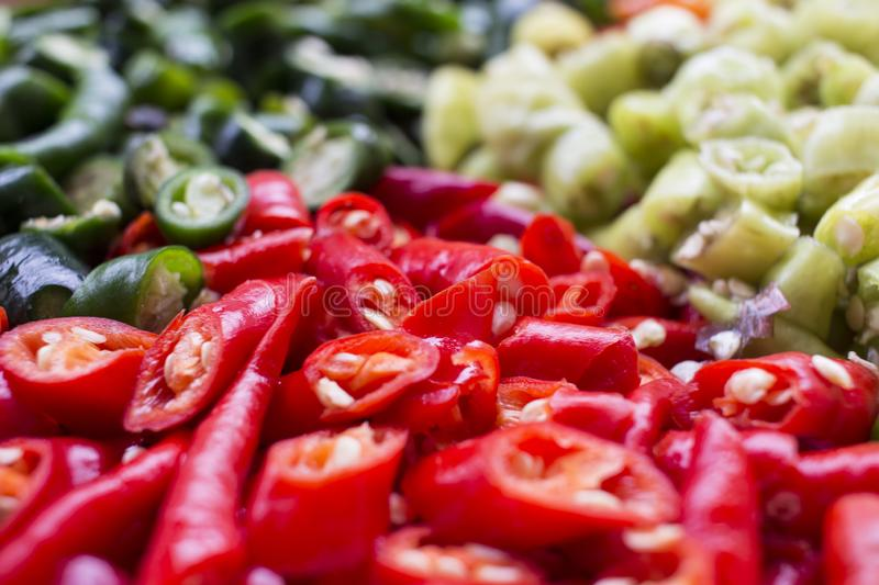 Top view of sliced red chili green chili and cayenne pepper. royalty free stock photos
