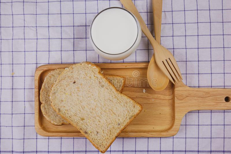 Top view sliced whole wheat bread on wooden plate royalty free stock photo