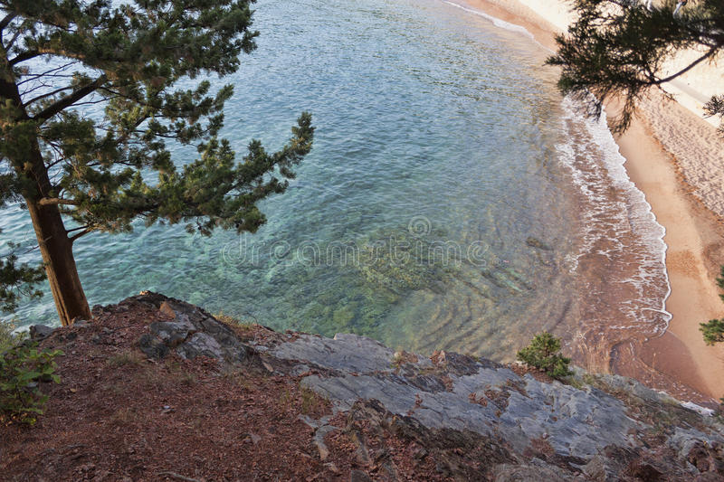 Top view of a small cove. Sheer cliffs, turquoise sea royalty free stock photo