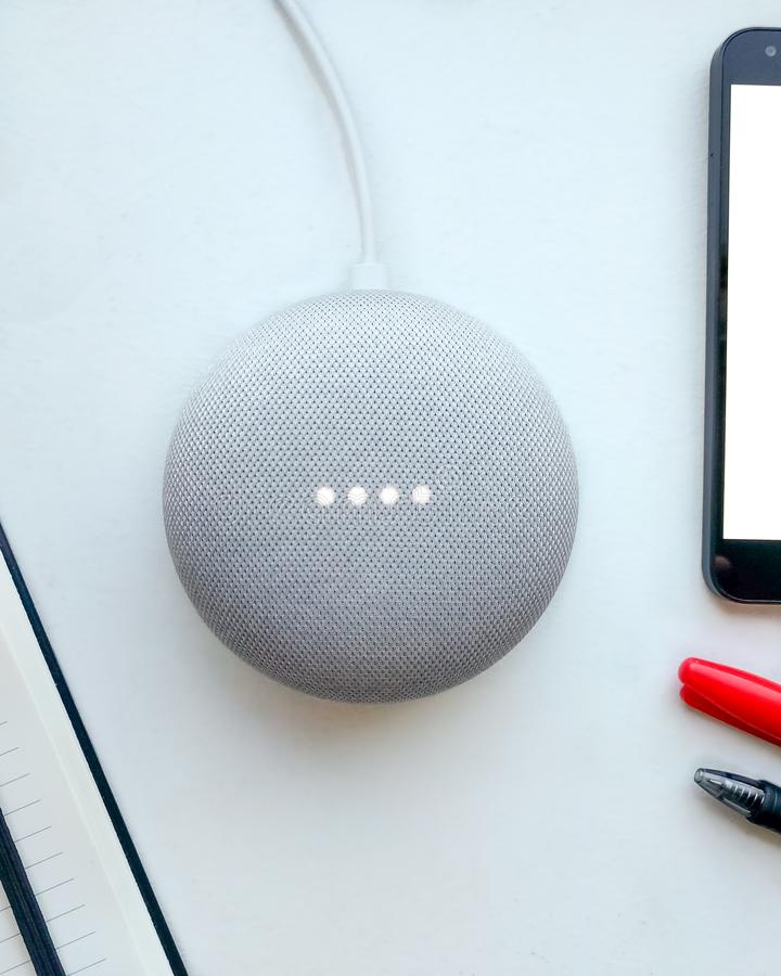 Digital Assistant. Smart speaker, mobile phone and notepad. stock photo