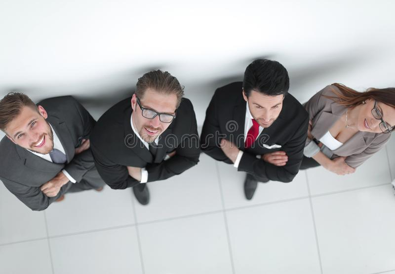Top view.smiling business team looking at the camera royalty free stock photo