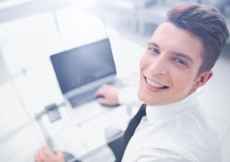 Top view.smiling businessman sitting at his Desk. stock photos