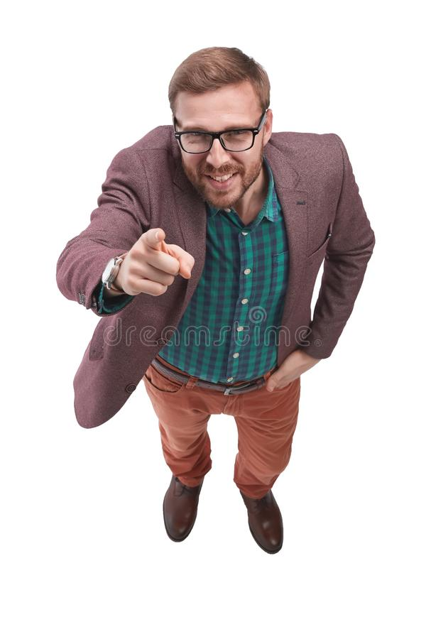 Top view. smiling man pointing at you. royalty free stock images