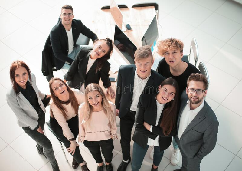 Top view. smiling young business team looking at the camera royalty free stock images