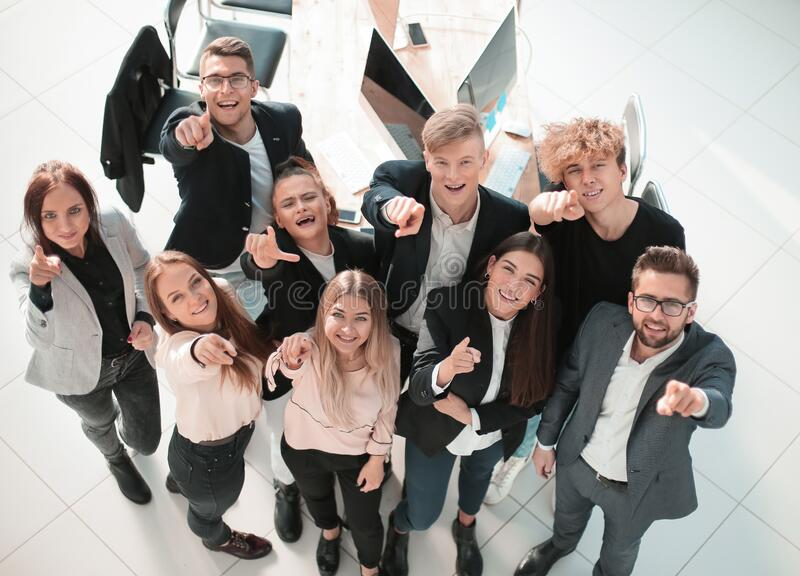 Top view. smiling young business team looking at the camera stock image
