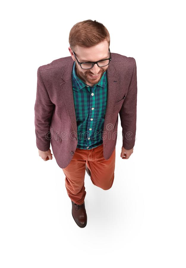Top view. smiling young man stepping forward stock images