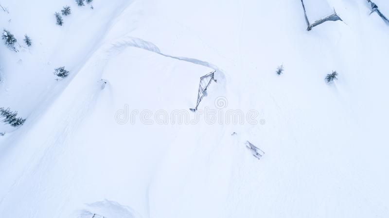 Top view of snow-covered huts in mountains stock image