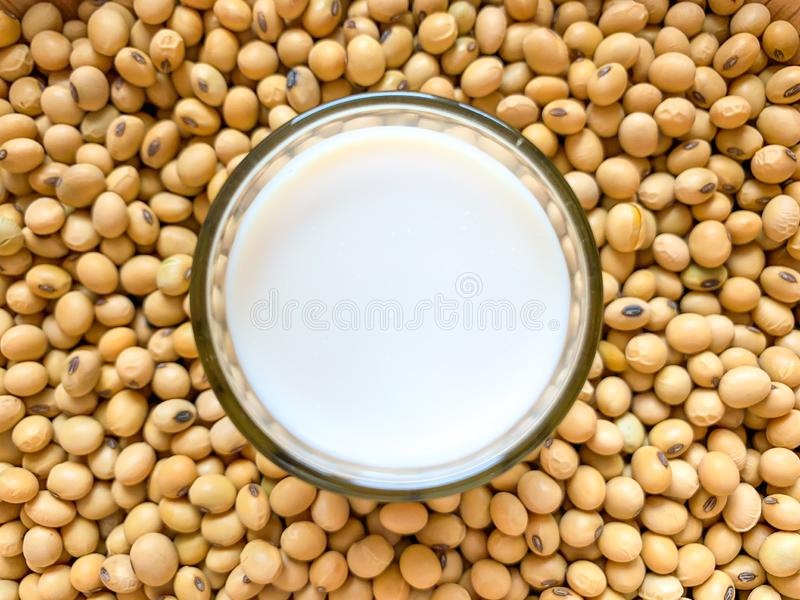 Top view of soymilk glass is placed on a lot of soybean piles royalty free stock photo