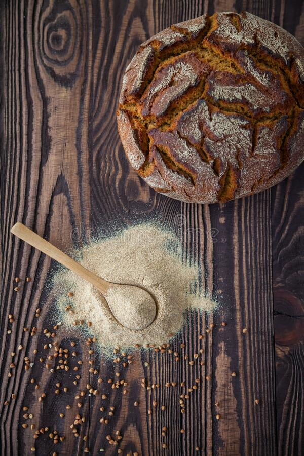 Free Top View Spoon With Buckwheat Flour And Bread Royalty Free Stock Photography - 203446127