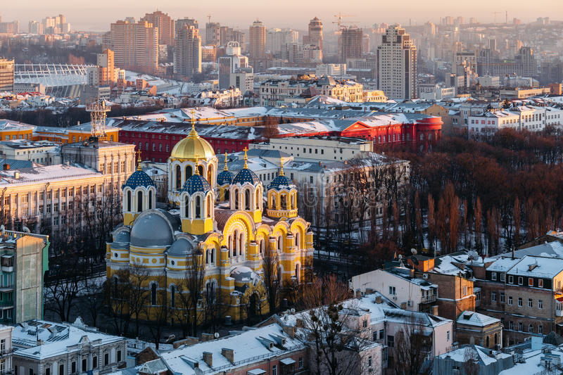 Top view of St. Vladimir`s Cathedral and the old city in Kiev, Ukraine at evening in winter stock photo