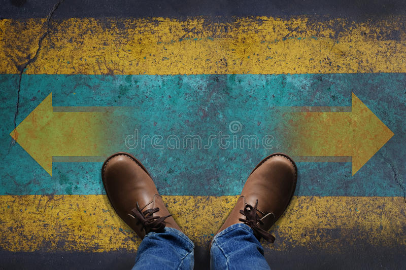 Top view, Stand over Arrow Sign on Grunge Floor, Making Decision stock images