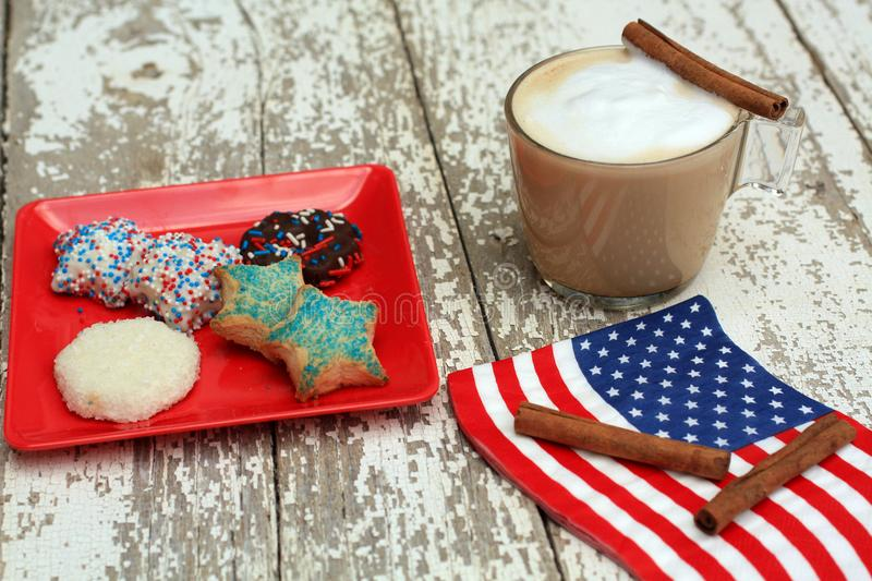 Front shot Cappucinno and cinnamon American star cookies royalty free stock image