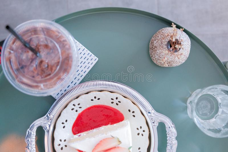 Top view of Strawberry shortcake on plate with ice chocolate. In cafe background and copy space for text stock images