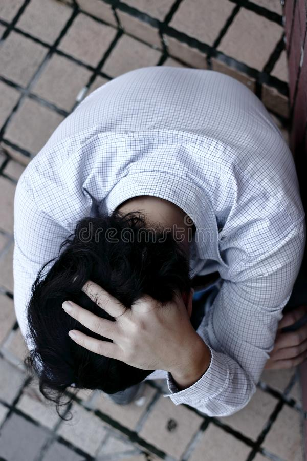Top view of stressed depressed young Asian man feeling bad stock photo