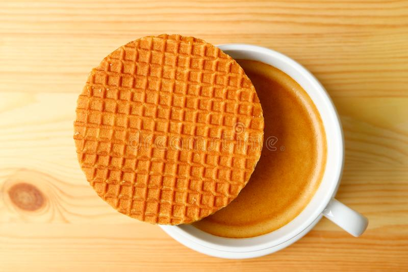 Top View of a Stroopwafel Placed on Top of Hot Coffee Cup Served on Wooden Table stock images