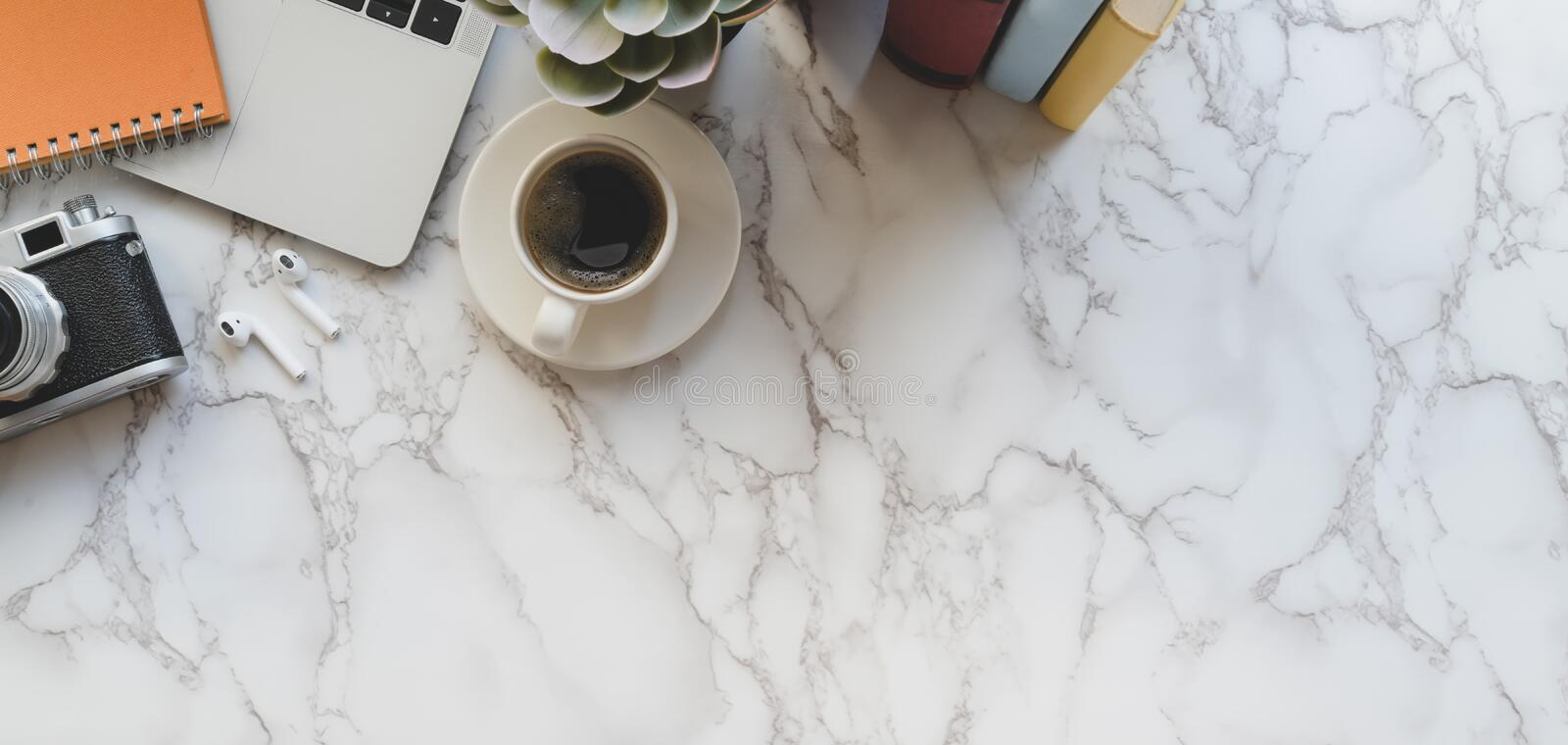 Top view of stylish photographer workspace with laptop computer and office supplies on marble desk royalty free stock photos