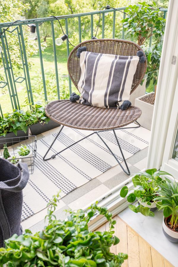 Top view of stylish rattan chair on the balcony of modern flat, real photo royalty free stock images