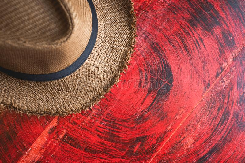 Top view of Summer brown panama straw hat on rustic red wood table.travel concept.copy space for adding text stock images