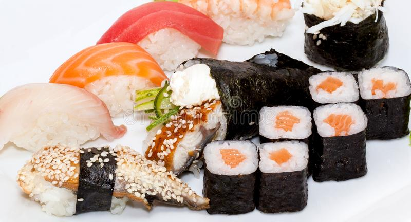 Top view on sushi set isolated over white background. Plate with rolls close-up stock photography