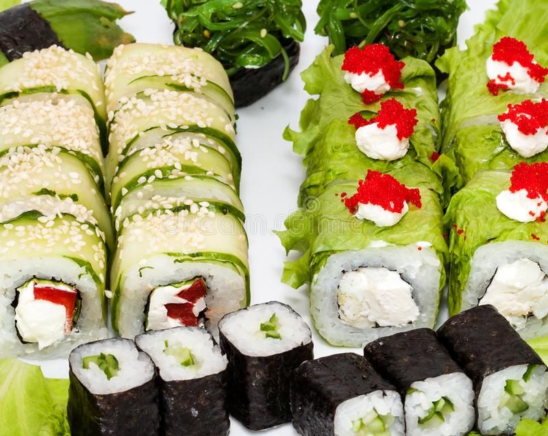Top view on sushi set isolated over white background. Plate with rolls close-up royalty free stock photography
