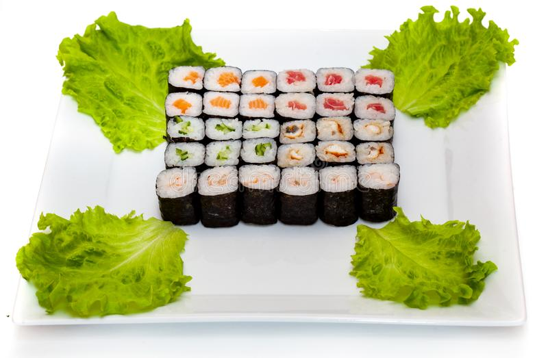 Top view on sushi set isolated over white background. Plate with rolls close-up stock photo