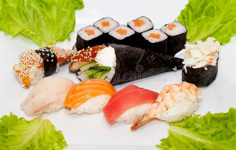 Top view on sushi set over white background. Plate with rolls close-up royalty free stock image