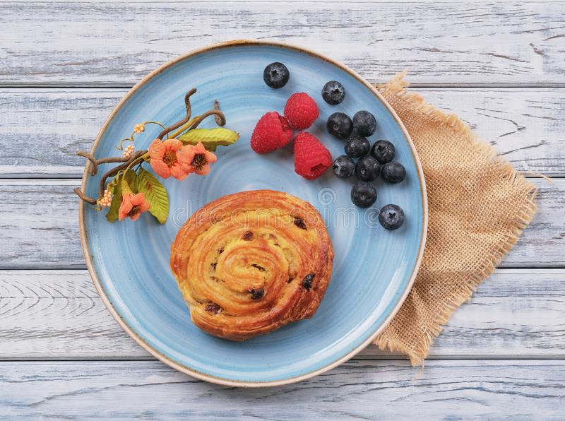 Top view on Sweet puff bun with cream in shape of snail royalty free stock images