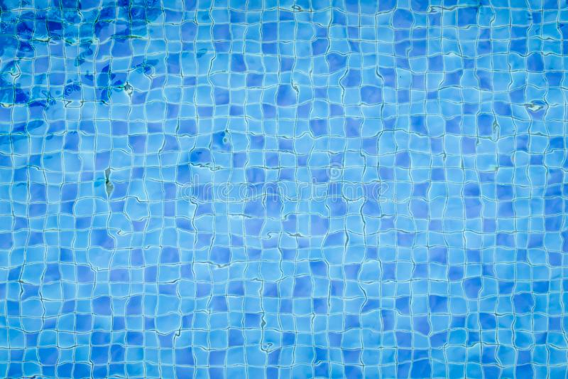 Top view swimming pool bottom caustics ripple and flow with wave. S background. Summer background. Texture of water surface royalty free stock images