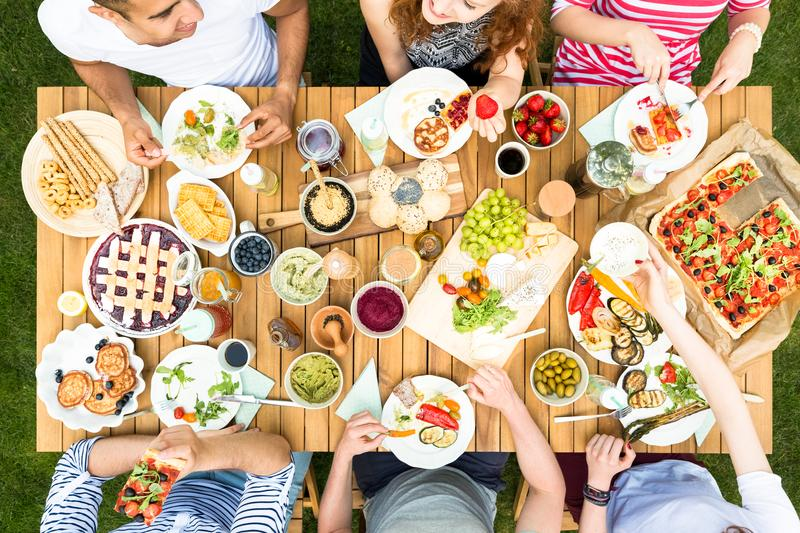 Top view on table with healthy food during meeting of friends stock photo