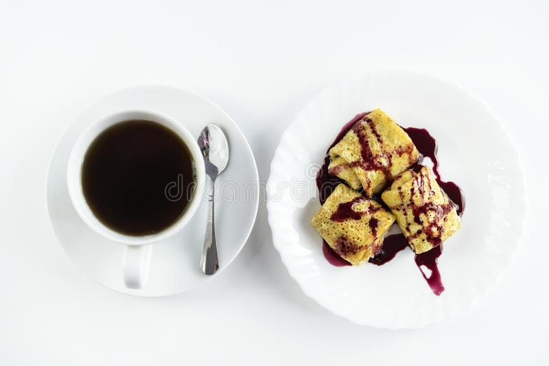 Top view of tasty traditional russian pancakes with coffee cup on white table stock image