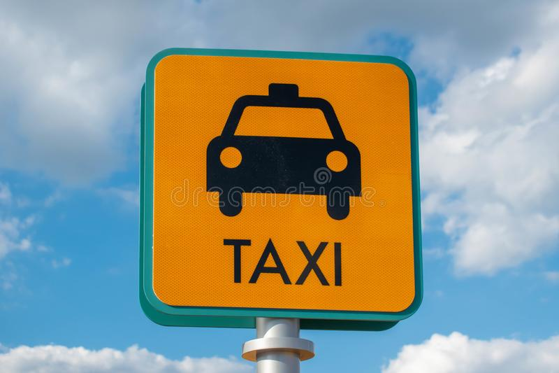 Top view of Taxi sign on lightblue cloudy sky background stock images