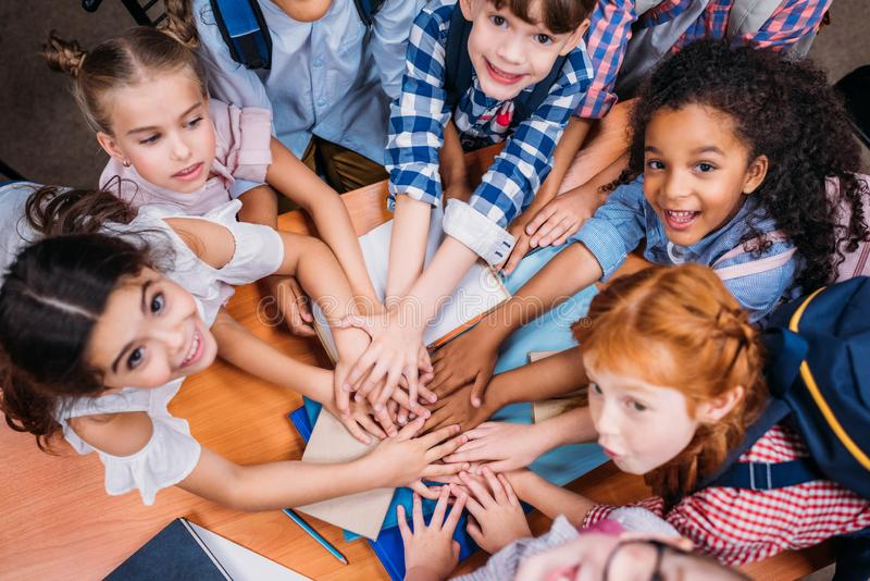 top view of team of adorable kids making stock photography