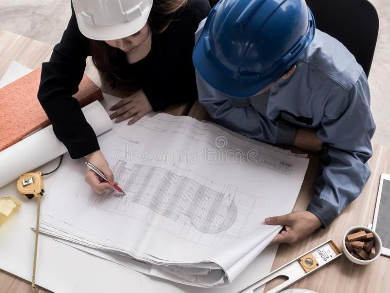 Top view teamwork concept, Engineer and workers discussing project of new building. ,Team of architects Asian people in group on royalty free stock photo