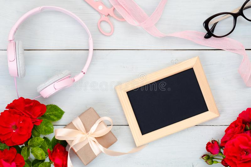 Top view teenage girl home office desk. Flat lay beauty blogger workspace with picture frame and feminine accessories on pastel. Blue wooden background. Fashion stock images