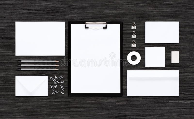 Top view of template mockup for branding identity on black table. Template mockup for corporate branding identity. Consists of paper, envelopes, business card royalty free stock photos