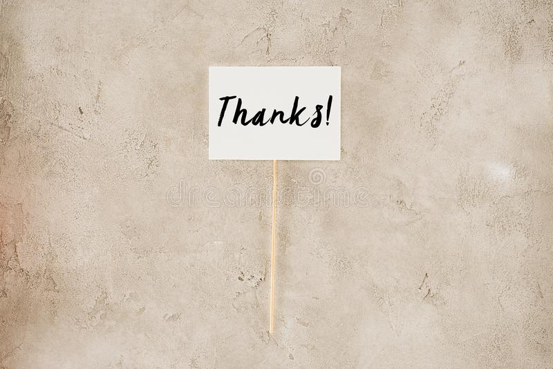 Top view of thanks lettering on placard. On concrete surface stock photography
