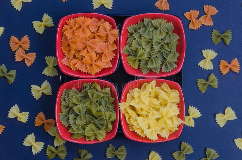 Top view of three color bow tie pasta royalty free stock photos