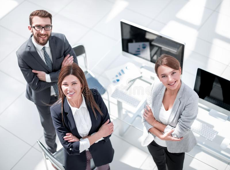 Top view. three employees standing in the office stock photography