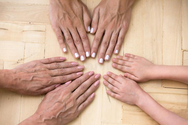 Top view of three generations of women put hands together royalty free stock photos