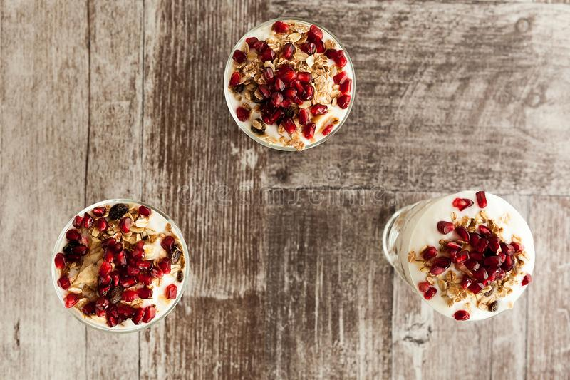 Top view of three glasses with delicious healthy home made muesli royalty free stock photo