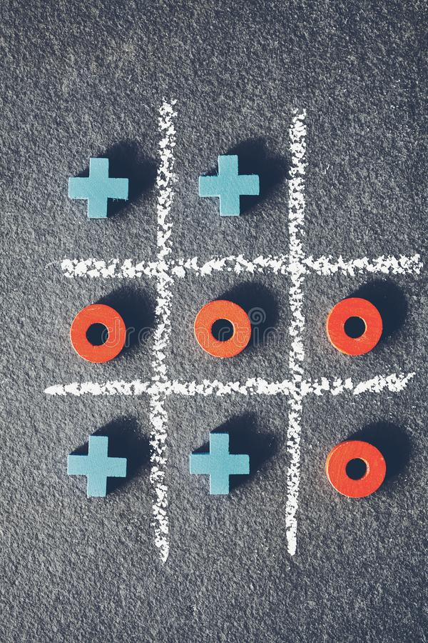 Top view of tic tac toe game on dark background. Top view of tic tac toe game noughts and crosses on dark background royalty free stock photos