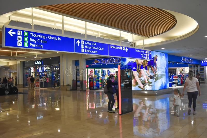 Top view of Ticketing and Check-in blue sign and Visitor Information touch screen at Orlando International Airport . royalty free stock images