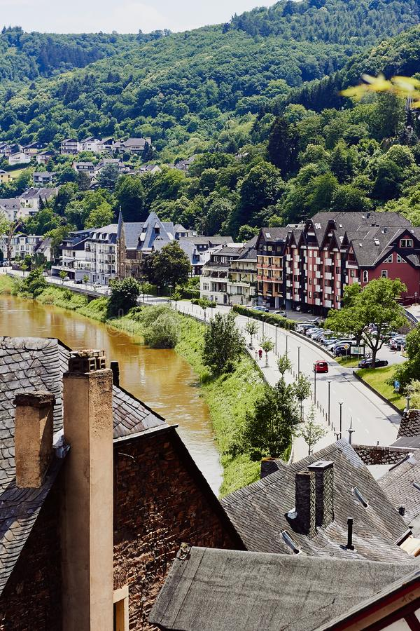 Top view of the tiled roofs of the medieval houses, the river Mosel and the road with cars. Germany, Europe royalty free stock images