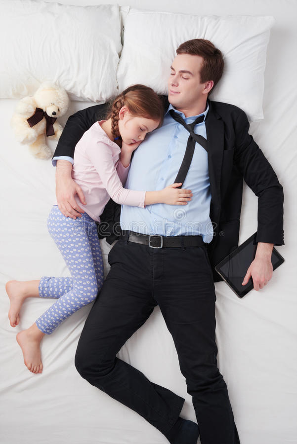 Top view of tired businessman and his little cute stock image