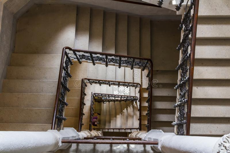 Top view to old stone castle indoor stair with wood handrail stock images