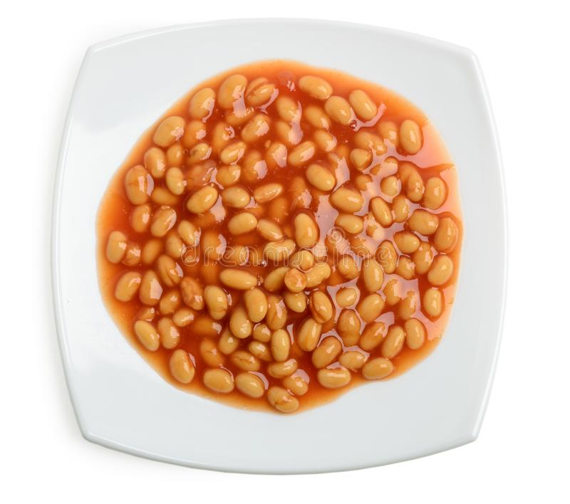 Tomato sauce white beans in a plate. Top view of tomato sauce white beans in a plate royalty free stock images