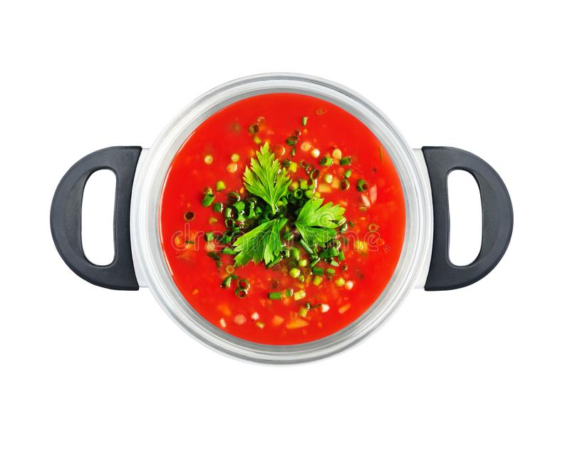 Top view of tomato soup in saucepan. Top view of red tomato soup or sauce in saucepan isolated on white background stock images